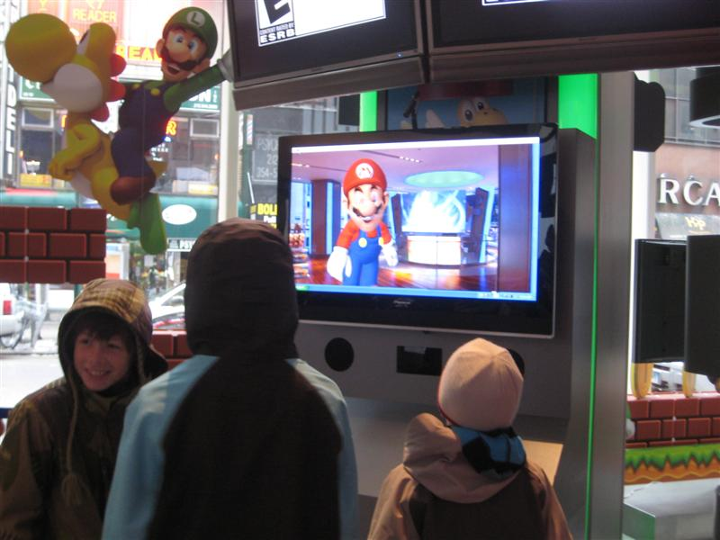 Kids playing with Mario at Nintendo World