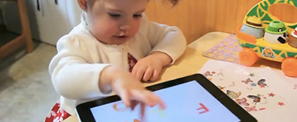 Child with an iPad
